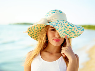 Woman At Beach Wearing Hat