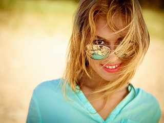 Happy Young Woman Wearing Sunglasses