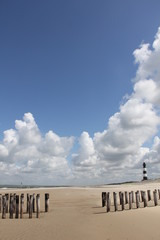 lighthouse and cumulus clouds Holland beach