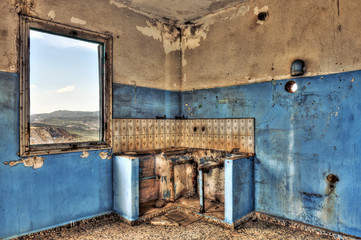 Derelict kitchen in abandoned house
