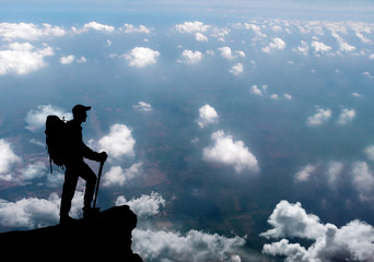 Man standing on summit of mountain.