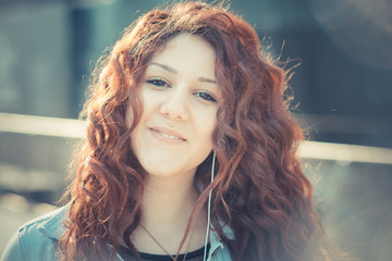 young beautiful hipster woman with red curly hair