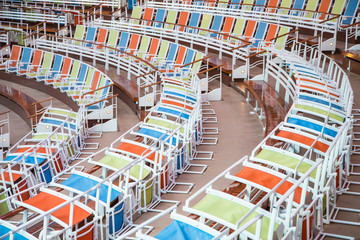 Curved Rows of Colorful Chairs in Stadium