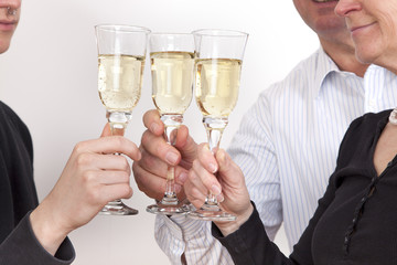 People celebrating with champagne your success
