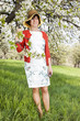 Woman with Straw Hat recovers under blooming cherry tree old