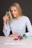 young beautiful blond woman with glass of champagne playing poke poster