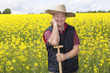 Man with straw hat in rape field