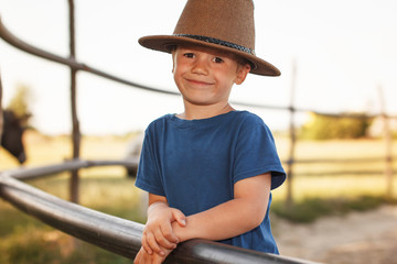 Kid in cowboy hat