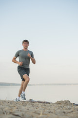 Male running beach