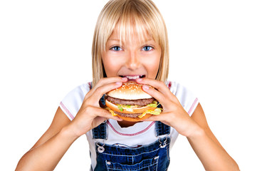 Pretty little girl eating a hamburger isolated on white