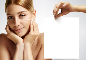 Beauty woman touching her face with a hand holding 3D note