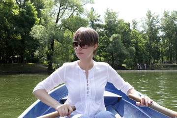 Girl rowing boat