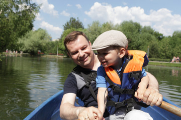 Father with son in rowboat