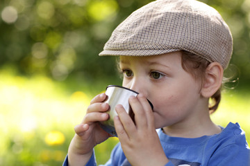 Kid drinking tea outdoor