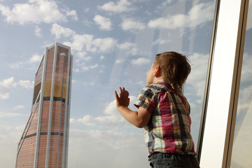 Kid looking at skyscrapers