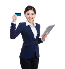 Asian business woman hold with digital tablet and credit card