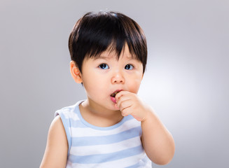 Baby boy eat finger food