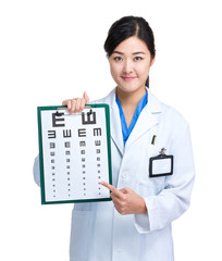 Asian doctor with eye chart