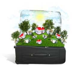 Houses, trees and green grass in travel bag
