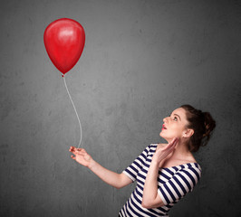 Woman holding a red balloon