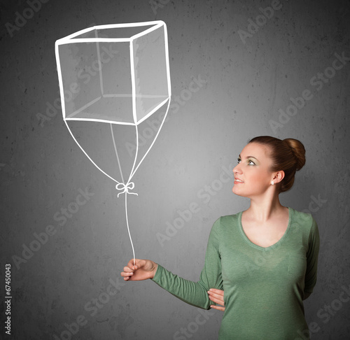 canvas print picture Woman holding a cube balloon