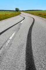 .Tire print on the asphalt road
