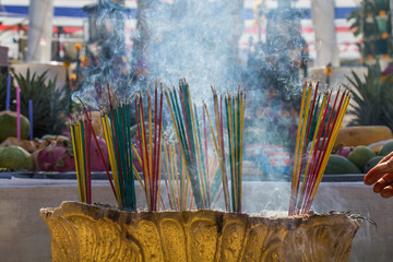 Burning the incense to worship the sacred