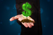 Young businessman presenting green glowing dollar sign