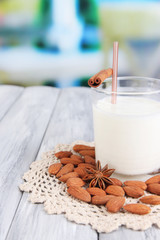 Almond milk in glass with almonds,