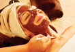 Spa therapy for young woman with chocolate mask at beauty salon