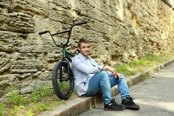 Young boy on BMX bike at park