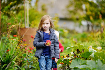 Cute little girl having fun in a garden