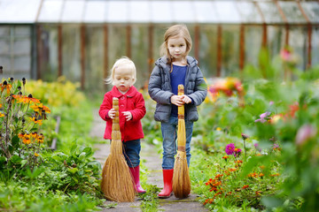 Two little sisters having fun in a garden
