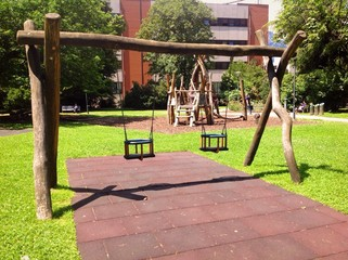 playground swings in urban park