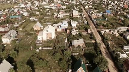 Flying over the village. Aerial Shot.