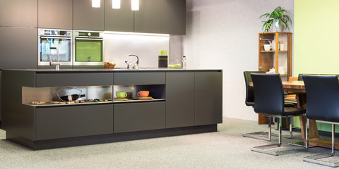 modern dark grey kitchen with illumination and sitting suite