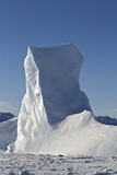 iceberg in the form of a high pole on a sunny winter day poster