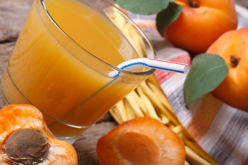 Apricot juice with fruit halves closeup horizontal
