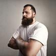 Tattooed brutal man wearing white t-shirt