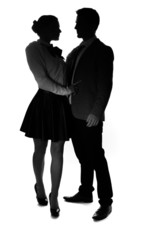 Loving young couple in silhouette