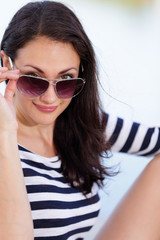 Woman removing her glasses stock image