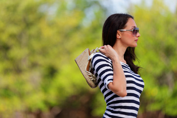 Woman in a striped shirt in nature stock image