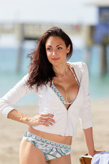 Beautiful woman at the beach with hand on hip