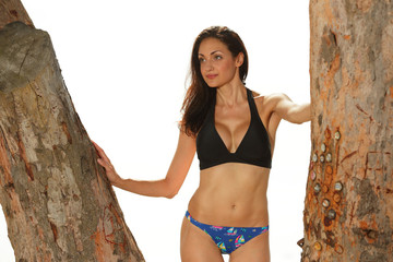 Bikini model between trees