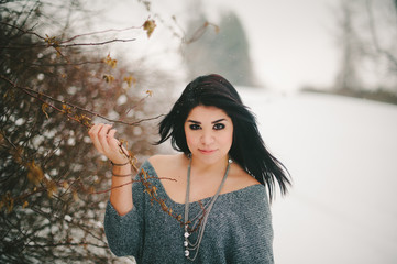 Beautiful Girl Holding Branches