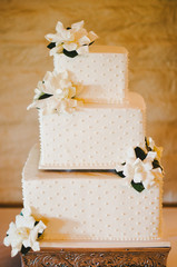 Ivory Square Layered Wedding Cake with Flowers