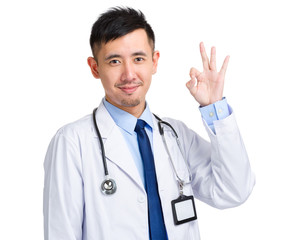 Asian male doctor with ok sign