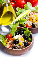 spelt salad on white background