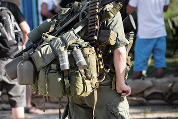 military with a backpack
