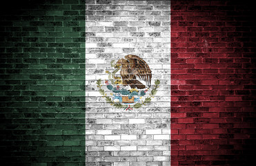 Mexican flag over a grunge background.